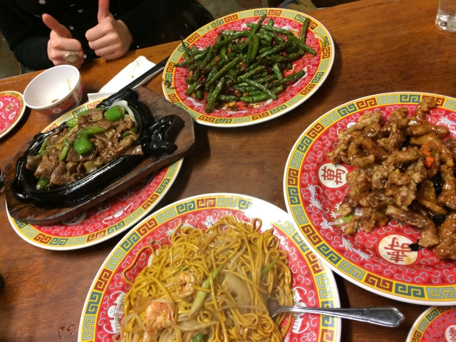 Sizzling beef, green beans, fried boodles & dry fried pork and some happy thumbs up